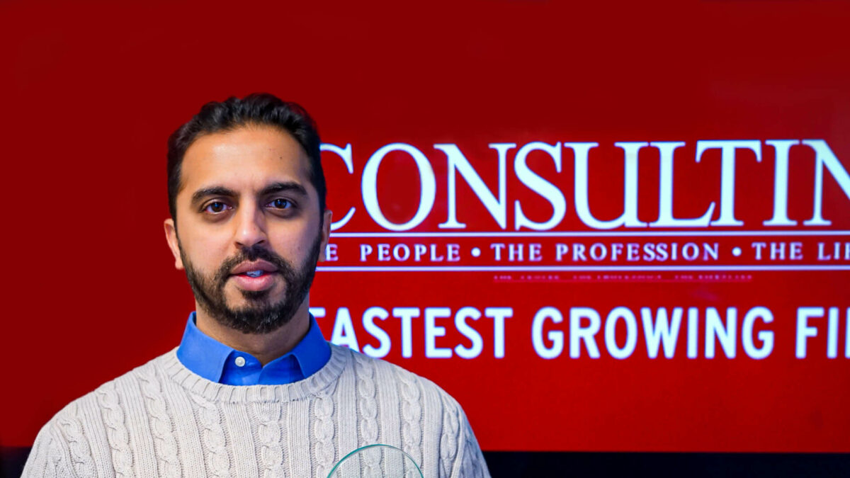 A photo of Jawad Shaikh receiving an award at a Consulting Magazine event in November 2019.